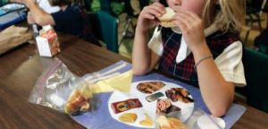 child eating food alone