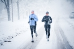 Two women run down Mountain Avenue in a snowstorm.